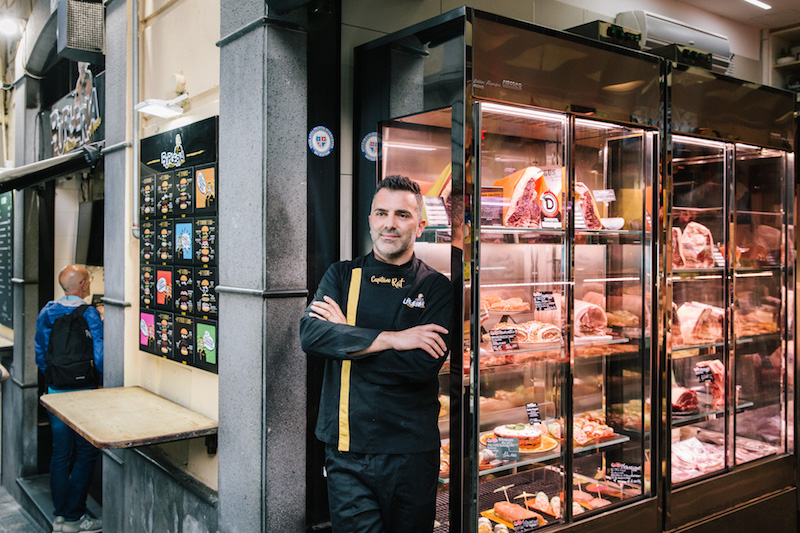 NAPLES, ITALY - 30 MAY 2019: Raffaele D'Ausilio (38, aka Capitano Raf) poses for a portrait in front of D'Ausilio Macelleria &amp; Burgheria, a butcher shop in Naples, Italy, on May 30th 2019.<br /> Raffaele D'Ausilio comes from a family of butchers. His grandfather, Alfredo d'Ausilio, opened a butcher shop in 1947. All four of his children became butchers, including Raffaele's father Vincenzo. In the early 2000s, Raffaele and his wife Roberta took over the family business with their touch of innovation: a butcher shop during the day, a take-away burger shop at night.