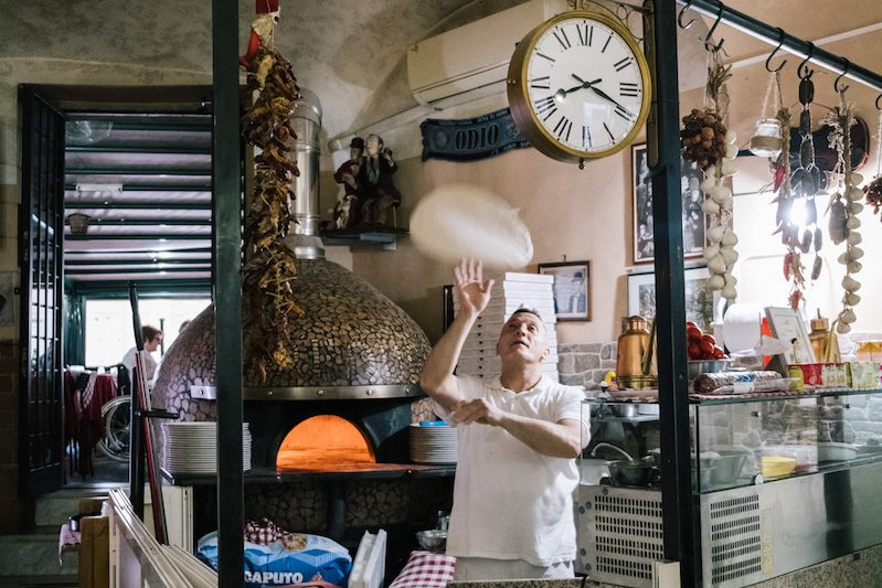 Beppe Sica tosses pizza dough, photo by Gianni Cipriano and Sara Smarrazzo