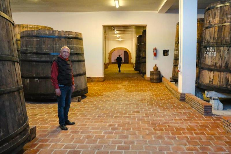 Anka-GujanidzeUNDP-of-the-old-Soviet-oak-barrels-in-Royal-Khvanchkara-wine-factory