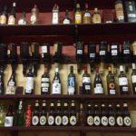 A Wall of Wine and Spirits at Bodega Manolo
