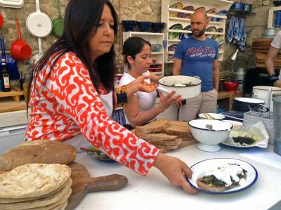 Chef AyşeNur Mıhcı presents her poached eggs with sautéed (chicory), photo by Jennifer Hattam