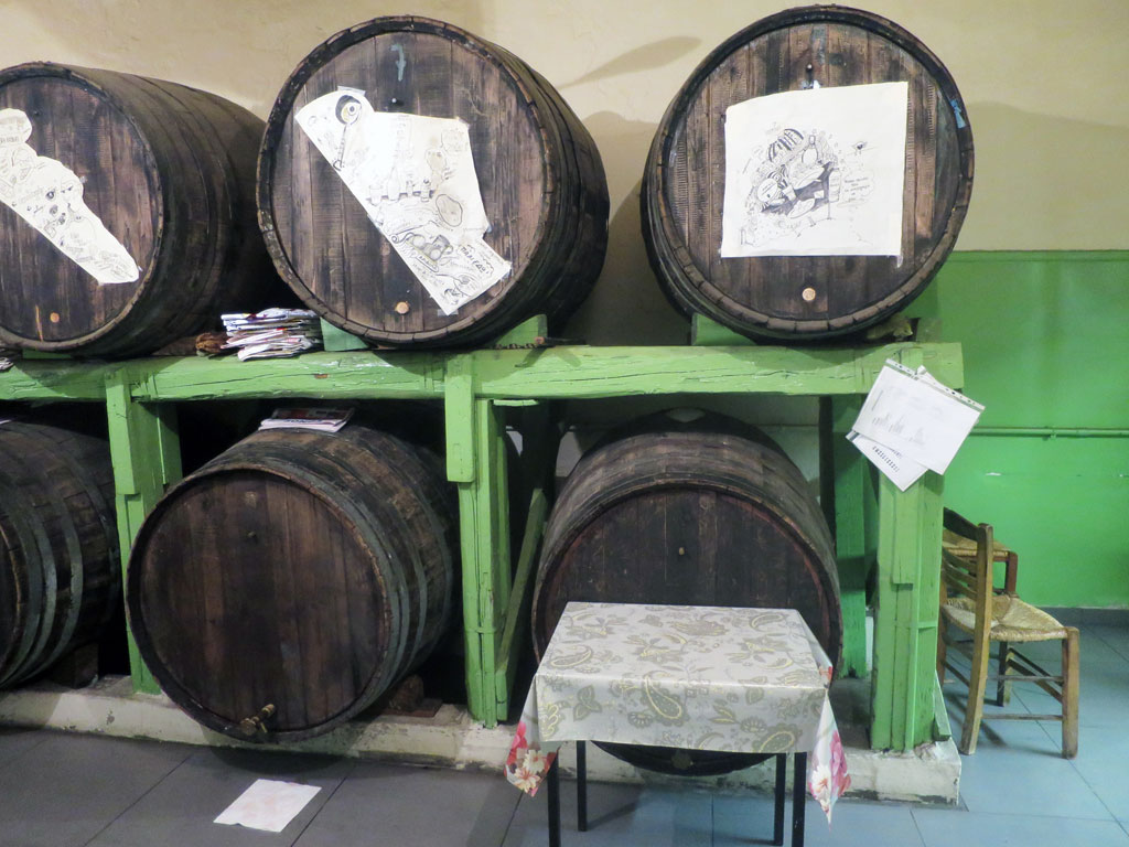 Barrels of house-made wine at Oinomagereion to Trifylli, photo by Johanna Dimopoulos