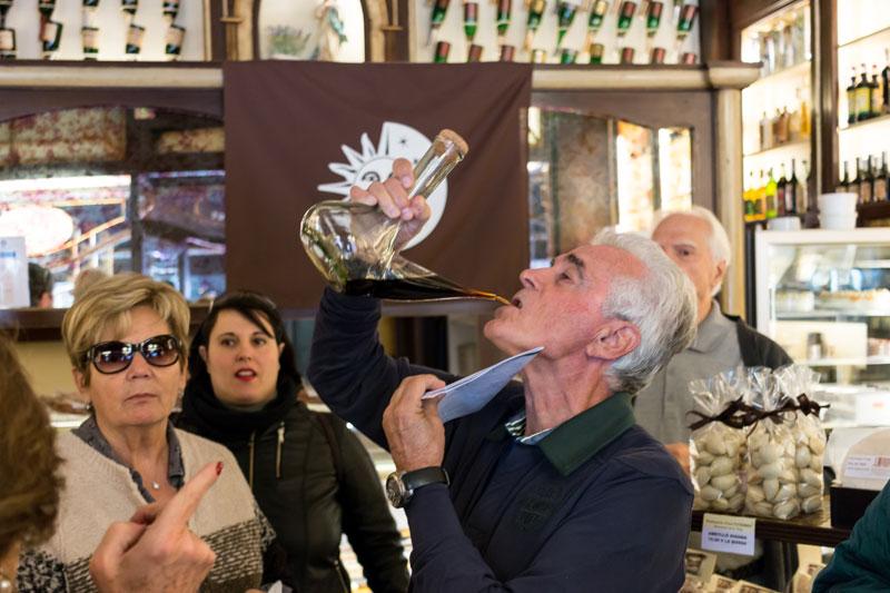 Drinking ratafia from a porron at Casa Tuyarro, photo by Sam Zucker