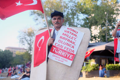 A shepherd in his traditional cloak at an anti-coup rally in Taksim Square. Photo by Paul Benjamin Osterlund