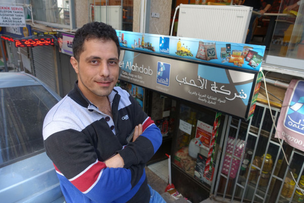 Jihad, owner of Al Ahdab market, photo by Ansel Mullins