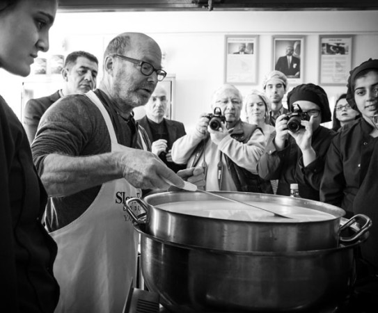 Cheesemaker Robert Paget teaches high school students how to make soft cheese at a Slow Cheese event, photo by Filiz Telek