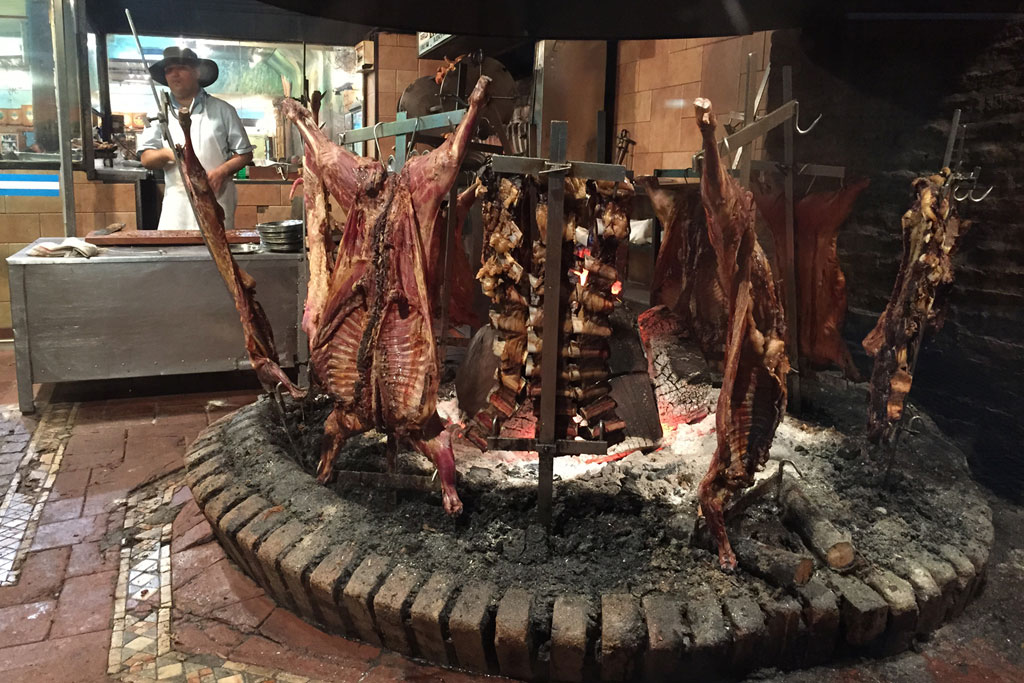 Beef grilling at an asador in Buenos Aires, photo by Paula Mourenza