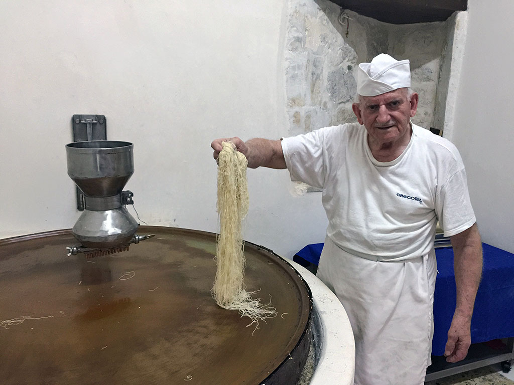 Giorgos Chatziparaschos, making kataifi in his workshop, photo by Marissa Tejada