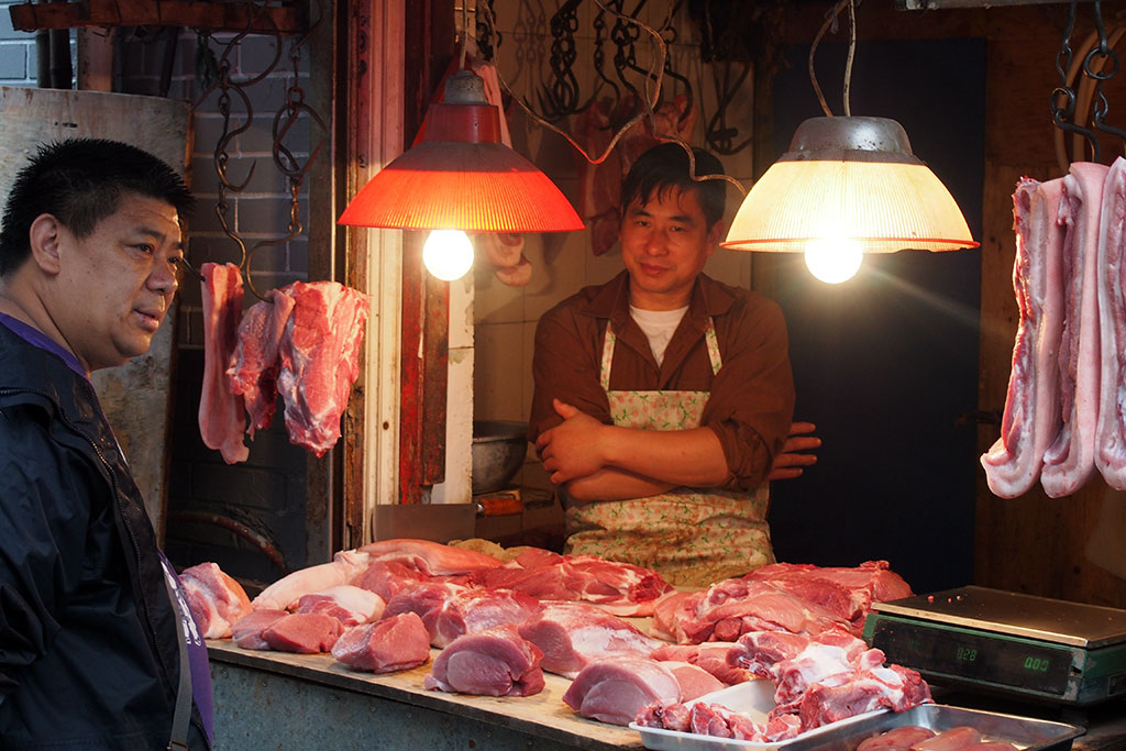 A meat seller at a wet market, photo by UnTour Shanghai