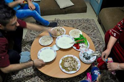 The family eating shakriyyeh together, photo by Dalia Mortada