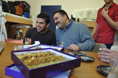 Mahmoud and Ahmed with pastries from Salloura in their dorm room in Birkenfeld, photo by Lauren Bohn