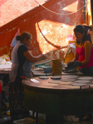 Vendors cooking on a comal at the Tepoztlán tianguis, photo by Margret Hefner