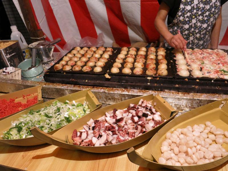 Takoyaki at a street festival, photo by Fran Kuzui