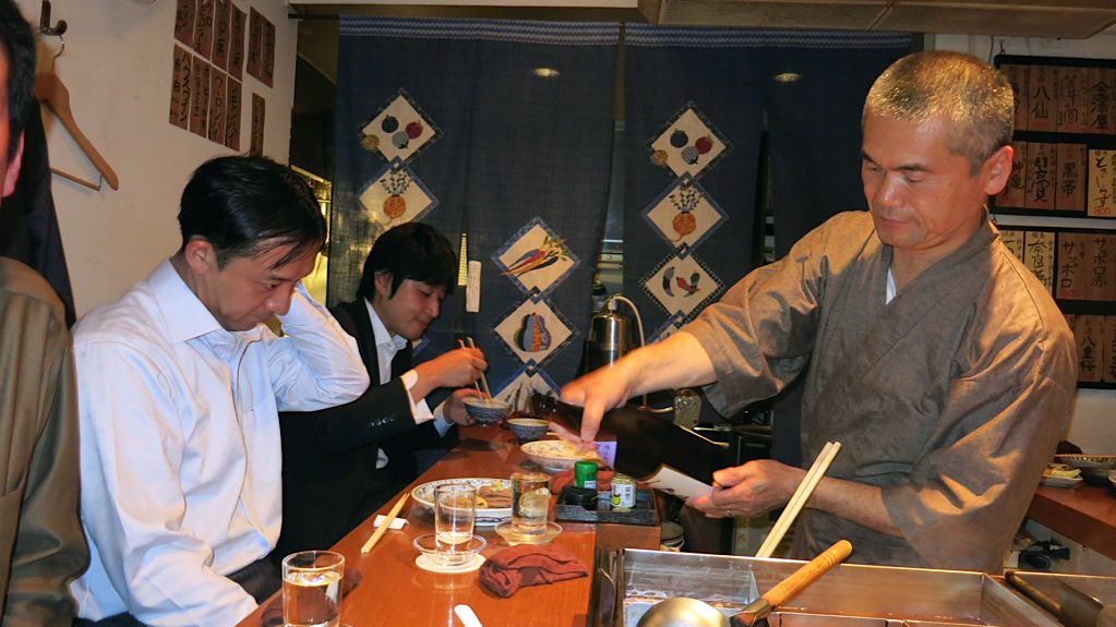 Some much-needed sake being served at Den, photo by Fran Kuzui